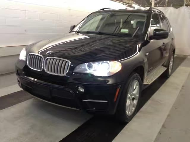 2013 BMW X5 35ipremium,细数高端配置:可展开式全景天窗,Hid大灯,Head-up display,卫星导航系统,
